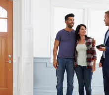 Couple with realtor looking at home